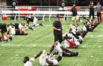 Atlanta Falcons stretch before practice during NFL football training camp Thursday, Sept. 3, 2020, in Atlanta. (Hyosub Shin/Atlanta Journal-Constitution via AP)