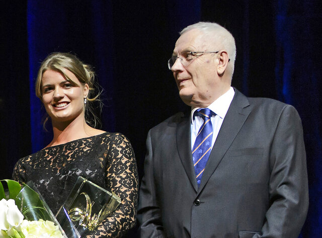 FILE - In this Saturday Oct. 17, 2015 file photo, European Athletics President Svein Arne Hansen looks on next to Dafne Schippers of the Netherlands during the European Athletics Golden Tracks ceremony, at the Swiss Tech Convention Center, in Lausanne, Switzerland. Hansen, the president of European Athletics and longtime organizer of the Bislett Games in Norway, has died. He was 74. The Norwegian Athletics Association confirmed Hansen's death on Saturday, June 20, 2020 saying there had been several complications with his health after he suffered a stroke on March 15. (Jean-Christophe Bott/Keystone via AP, file)