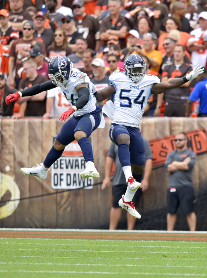 Tennessee Titans inside linebacker Rashaan Evans (54) and strong safety Kenny Vaccaro (24) celebrate a safety during the first half in an NFL football game against the Cleveland Browns, Sunday, Sept. 8, 2019, in Cleveland. (AP Photo/David Richard)