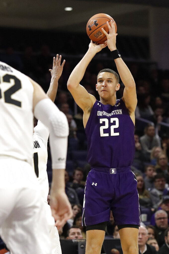 Northwestern forward Pete Nance, right, shoots against Purdue during the second half of an NCAA college basketball game in Evanston, Ill., Saturday, Feb. 1, 2020. (AP Photo/Nam Y. Huh)