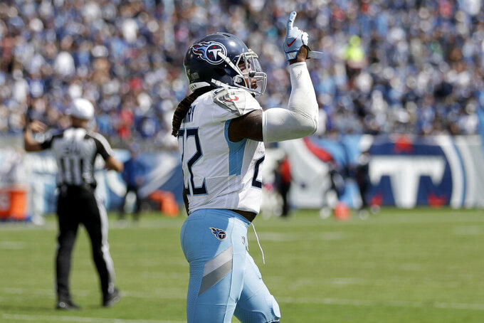 Tennessee Titans running back Derrick Henry celebrates after scoring a touchdown against the Indianapolis Colts in the second half of an NFL football game Sunday, Sept. 15, 2019, in Nashville, Tenn. (AP Photo/James Kenney)