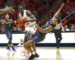 Washington forward Nahziah Carter, right, fouls Utah forward Both Gach during the second half of an NCAA college basketball game Thursday, Jan., 10, 2019, in Salt Lake City. (AP Photo/Rick Bowmer)