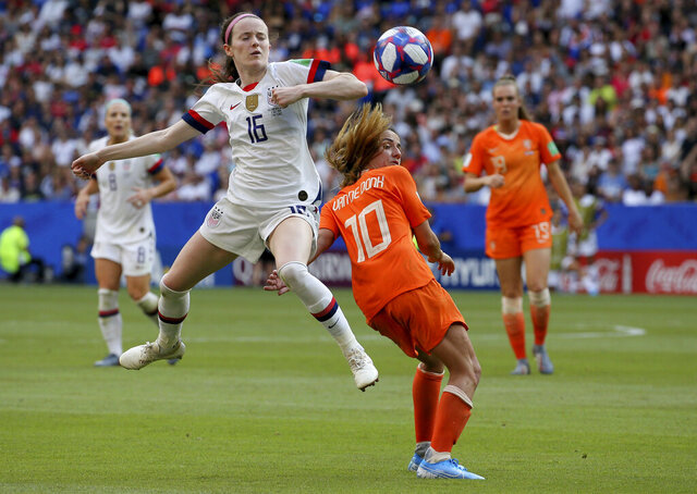 FILE - In this July 7, 2019, file photo, United States' Rose Lavelle, left, is challenged by Netherlands' Danielle Van De Donk during the Women's World Cup final soccer at the Stade de Lyon in Decines, outside Lyon, France. Twenty players have been named to the U.S. women's soccer team that will play for a spot in the Tokyo Olympics. Coach Andonovski announced the roster for the CONCACAF Olympic qualifying tournament Friday, Jan. 17, 2020. (AP Photo/David Vincent, File)