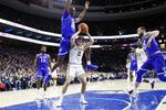 Villanova's Collin Gillespie (2) is fouled by Seton Hall's Romaro Gill (35) during the first half of an NCAA college basketball game, Saturday, Feb. 8, 2020, in Philadelphia. (AP Photo/Matt Slocum)