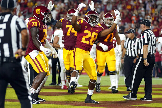 Southern California running back Keaontay Ingram (28) celebrates his rushing touchdown during the first half of the team's NCAA college football game against Stanford on Saturday, Sept. 11, 2021, in Los Angeles. (AP Photo/Marcio Jose Sanchez)