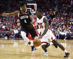 Miami Heat guard Kendrick Nunn, right, dribbles past Houston Rockets forward Danuel House Jr., left, during the first half of an NBA basketball game, Wednesday, Nov. 27, 2019, in Houston. (AP Photo/Eric Christian Smith)