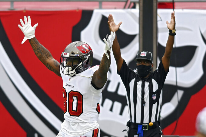 Tampa Bay Buccaneers running back Ke'Shawn Vaughn (30) celebrates after scoring against the Los Angeles Chargers during the second half of an NFL football game Sunday, Oct. 4, 2020, in Tampa, Fla. (AP Photo/Jason Behnken)