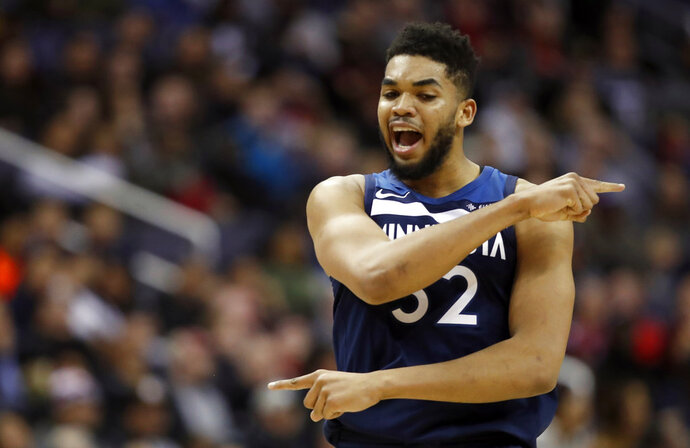 Minnesota Timberwolves center Karl-Anthony Towns celebrates during the second half of an NBA basketball game against the Washington Wizards, Tuesday, March 13, 2018, in Washington. The Timberwolves won 116-111. (AP Photo/Alex Brandon)