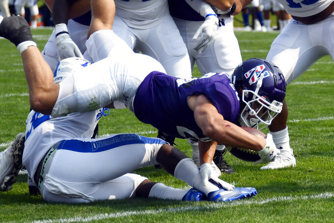 Northwestern running back Evan Hull scores a touchdown against Indiana State during the first half of an NCAA college football game in Evanston, Ill, Saturday, Sept. 11, 2021. (AP Photo/Matt Marton)