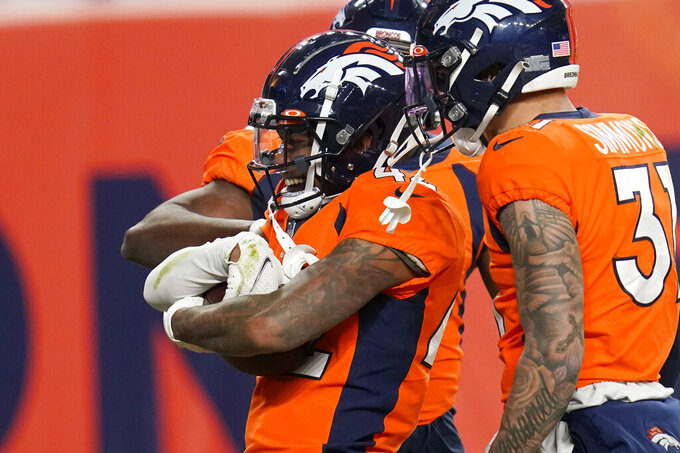 Denver Broncos cornerback Parnell Motley (42) celebrates after recovering a fumble by the Las Vegas Raiders during the second half of an NFL football game, Sunday, Jan. 3, 2021, in Denver. (AP Photo/David Zalubowski)