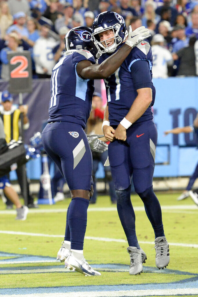 Tennessee Titans quarterback Ryan Tannehill (17) is congratulated by A.J. Brown (11) after Tannehill scored a touchdown on a 4-yard run against the Buffalo Bills in the first half of an NFL football game Monday, Oct. 18, 2021, in Nashville, Tenn. (AP Photo/Mark Zaleski)