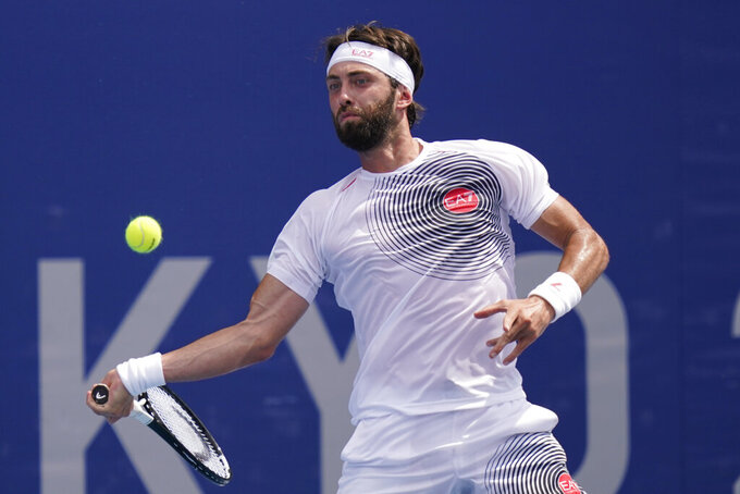 Nikoloz Basilashvili, of Georgia, plays against Lorenzo Sonego, of Italy, during the second round of the tennis competition at the 2020 Summer Olympics, Monday, July 26, 2021, in Tokyo, Japan. (AP Photo/Seth Wenig)