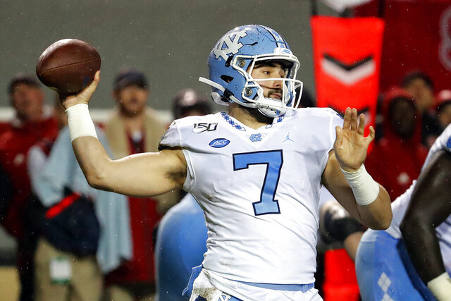 North Carolina quarterback Sam Howell (7) passes the ball against North Carolina State during the first half of an NCAA college football game in Raleigh, N.C., Saturday, Nov. 30, 2019. (AP Photo/Karl B DeBlaker)