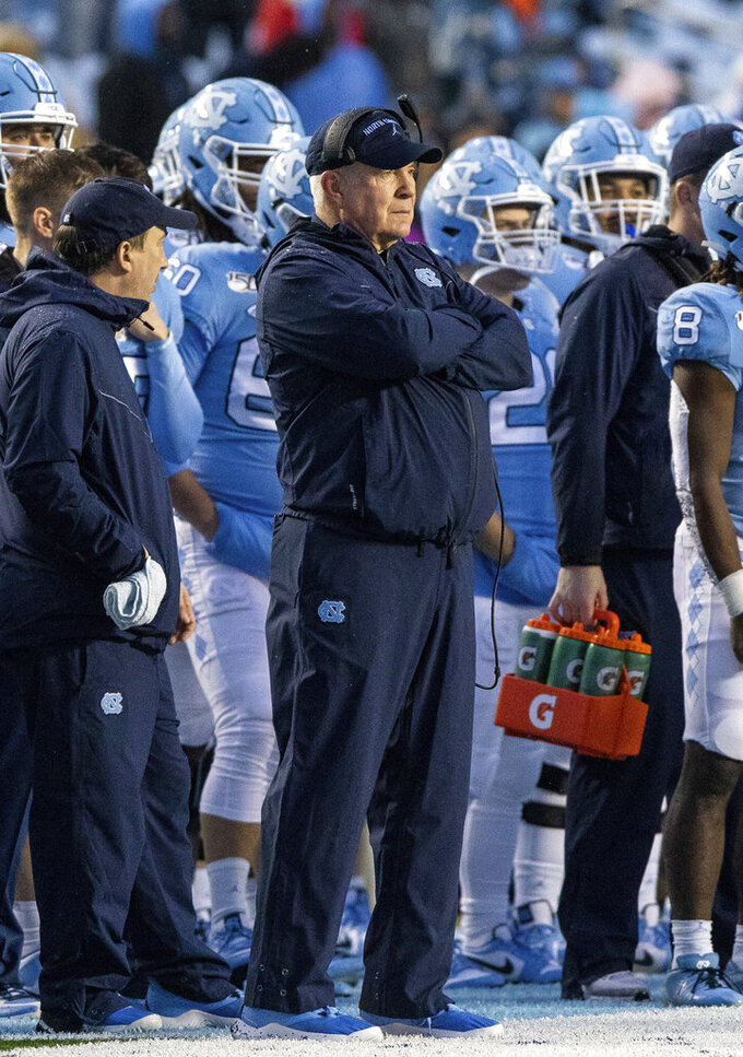 North Carolina head coach Mack Brown watches from the sideline during the first half of an NCAA college football game against Mercer in Chapel Hill, N.C., Saturday, Nov. 23, 2019. (AP Photo/Ben McKeown)