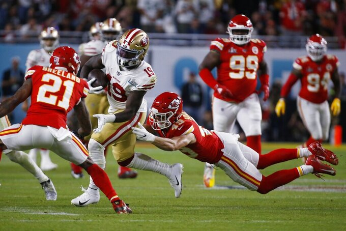 San Francisco 49ers' Deebo Samuel (19) runs between Kansas City Chiefs' Bashaud Breeland (21) and Daniel Sorensen during the second half of the NFL Super Bowl 54 football game, Sunday, Feb. 2, 2020, in Miami Gardens, Fla. (AP Photo/Mark Humphrey)