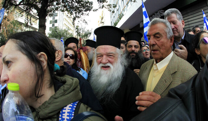 FILE - In this Feb. 4, 2018 file photo, Greek Orthodox Bishop Amvrosios takes part in a rally against an agreement with neighbouring Macedonia over its name, in Athens, Greece. The Metropolitan Amvrosios of Kalavryta, a fiery conservative Greek Orthodox bishop known for criticizing, often in intemperate terms, those who he believed acted in a