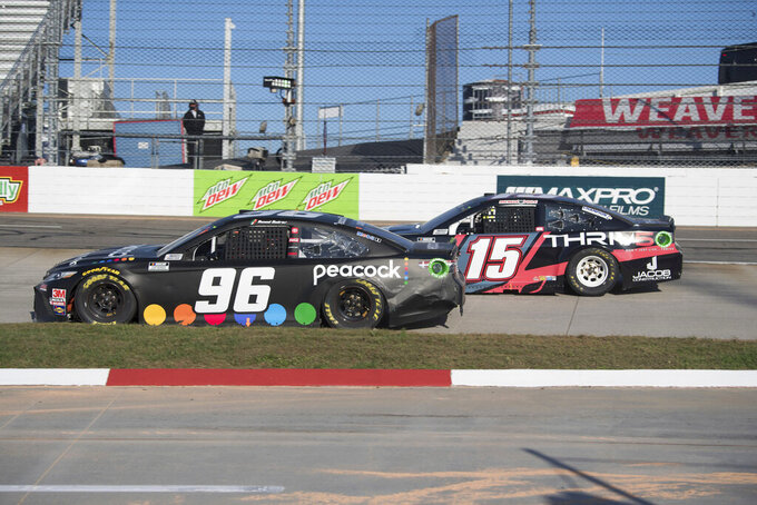 Daniel Suarez (96) drives turn 3 followed by Brennan Poole (15) during a NASCAR Cup Series auto race at the Martinsville Speedway in Martinsville, Va., Sunday, Nov.1, 2020. (AP Photo/Lee Luther Jr.)
