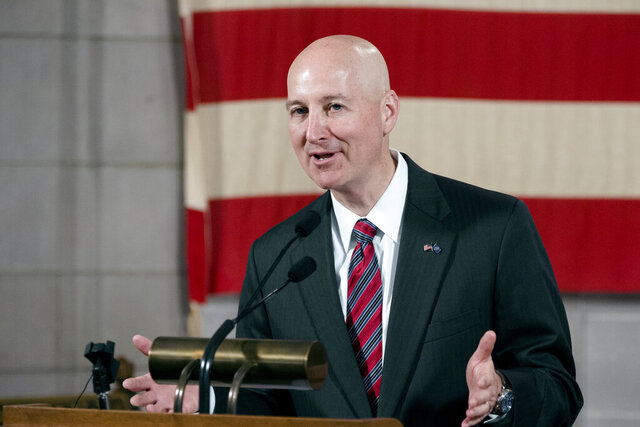 FILE - Nebraska Gov. Pete Ricketts speaks in Lincoln, Neb., Monday, July 20, 2020. Ricketts vetoed a bill Monday, Aug. 17, 2020 that would have prohibited prison officials from blocking the view of execution witnesses before the condemned inmate is declared dead, signaling that they're willing to repeat the much-criticized step in a future execution. (AP Photo/Nati Harnik)