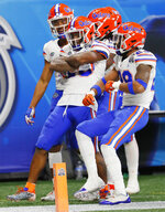 Florida players celebrate a run against Michigan during the first half of the Peach Bowl NCAA college football game, Saturday, Dec. 29, 2018, in Atlanta. (AP Photo/John Bazemore)