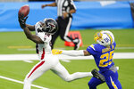 Atlanta Falcons wide receiver Calvin Ridley (18) catches a touchdown pass in front of Los Angeles Chargers cornerback Chris Harris Jr. during the first half of an NFL football game Sunday, Dec. 13, 2020, in Inglewood, Calif. (AP Photo/Ashley Landis)