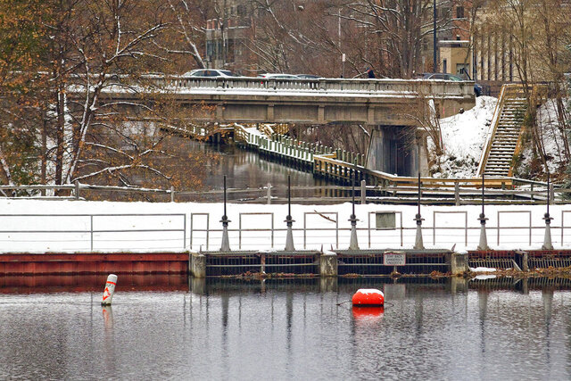 The Union Street Dam, foreground, the last remaining dam on the Boardman River is seen in Traverse City, Mich., on Dec. 4, 2020. Construction on FishPass, a selective two-way fish-sorting system slated to replace the dam could start in mid-January. (Jan-Michael Stump/Traverse City Record-Eagle via AP)