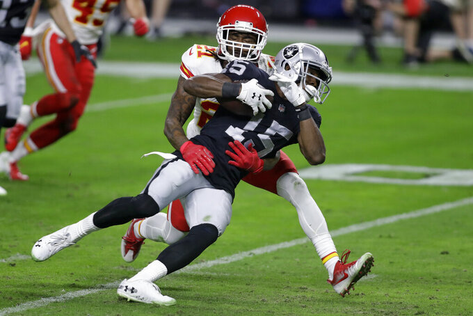 Kansas City Chiefs cornerback Bashaud Breeland (21) tackles Las Vegas Raiders wide receiver Nelson Agholor (15) during the first half of an NFL football game, Sunday, Nov. 22, 2020, in Las Vegas. (AP Photo/Isaac Brekken)