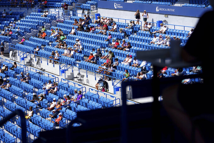 Tennis fans watch the match between Angelique Gerber, of Germany, and Elina Svitolina, of Ukraine, Wednesday, Aug. 18, 2021, during the Western & Southern Open tennis tournament at the Lindner Family Tennis Center in Mason, Ohio. (Kareem Elgazzar/The Cincinnati Enquirer via AP)