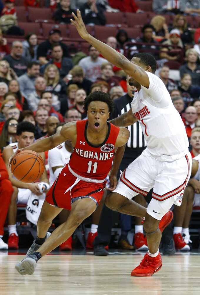 Southeast Missouri State's DQ Nicholas, left, drives the baseline around Ohio State's Luther Muhammad during the first half of an NCAA college basketball game Tuesday, Dec. 17, 2019, in Columbus, Ohio. (AP Photo/Jay LaPrete)