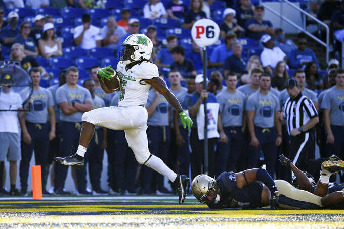 Marshall running back Sheldon Evans (5) runs the ball for a touchdown during the second half of an NCAA college football game against Navy, Saturday, Sept. 4, 2021, Annapolis, Md. (AP Photo/Terrance Williams)