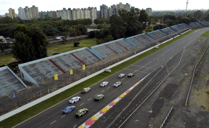 Vitarti Girl's Team drivers Karina Dobal and Rocio Migliore compete in the team's first race at the Oscar y Juan Galvez track in Buenos Aires, Argentina, Sunday, April 4, 2021. In their debut race, the rooky female team finished second. (AP Photo/Natacha Pisarenko)