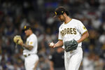 San Diego Padres starting pitcher Yu Darvish (11) looks down at the ball after getting his 1,500th career strikeout during the fifth inning of a baseball game against the Los Angeles Dodgers, Monday, June 21, 2021, in San Diego. (AP Photo/Denis Poroy)