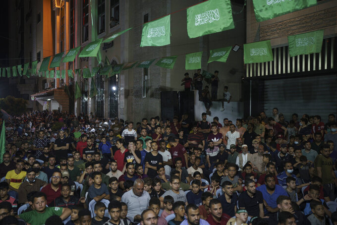 Palestinians gather during a Hamas rally in Gaza City, Wednesday, June 9, 2021. Hamas militants held a rally to commemorate the members of the group who were killed in an 11-day war with Israel in May. (AP Photo/Felipe Dana)