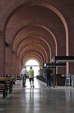 In this photo made Thursday, July 23, 2020, an view of the walkway arches are shown at the new Texas Rangers home baseball stadium named Globe Life Field in Arlington, Texas. The Texas Rangers' new stadium isn't retro and designers wanted the first next-generation ballpark. There is the full-panel retractable roof, the split seating levels offering full views of the ballpark with plenty of natural light. (AP Photo/LM Otero)