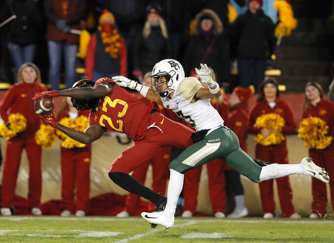 Iowa State wide receiver Matthew Eaton, left, makes a catch for a first down as Baylor cornerback Raleigh Texada, right, trails behind during the second half of an NCAA college football game, Saturday, Nov. 10, 2018, in Ames, Iowa.  (AP Photo/Matthew Putney)