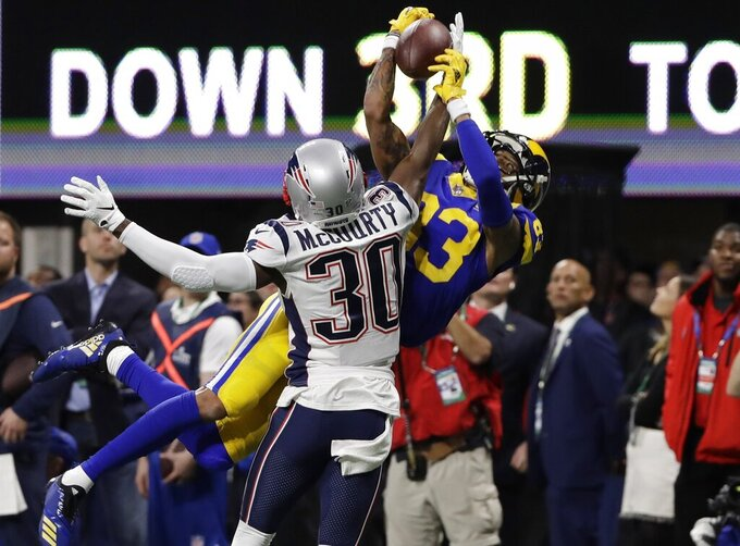 New England Patriots' Jason McCourty (30) breaks up pass intended Los Angeles Rams' Josh Reynolds (83), during the first half of the NFL Super Bowl 53 football game Sunday, Feb. 3, 2019, in Atlanta. (AP Photo/Frank Franklin II)