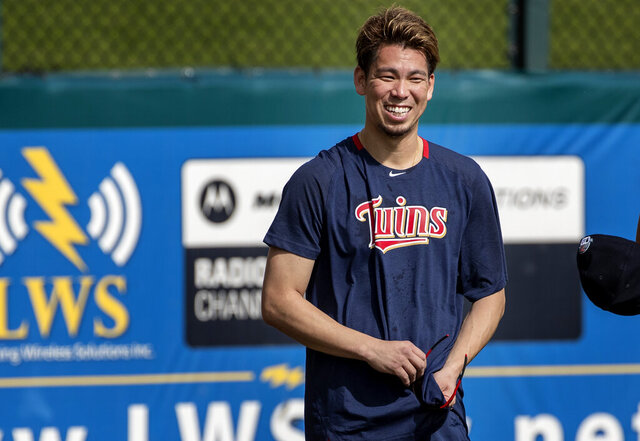 Minnesota Twins pitcher Kenta Maeda watches during spring training baseball practice on Thursday., Feb. 13, 2020 in Fort Myers, Fla. The Minnesota Twins welcome Kenta Maeda to their rotation, after a held-up trade was finally completed with the Los Angeles Dodgers. (Carlos Gonzalez/Star Tribune via AP)