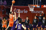 Illinois forward Giorgi Bezhanishvili (15) puts up a shot against Northwestern in the first half of an NCAA college basketball game Tuesday, Feb. 16, 2021, in Champaign, Ill. (AP Photo/Holly Hart)