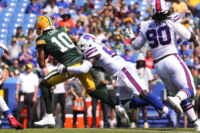 Green Bay Packers quarterback Jordan Love (10) is sacked by Buffalo Bills linebacker Andre Smith, center, during the second half of a preseason NFL football game, Saturday, Aug. 28, 2021, in Orchard Park, N.Y. (AP Photo/Jeffrey T. Barnes)