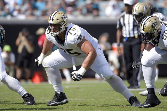 FILE - In this Oct. 13, 2019 file photo, New Orleans Saints offensive guard Andrus Peat (75) sets up to block during the second half of an NFL football game against the Jacksonville Jaguars in Jacksonville, Fla. Saints free agent left guard Andrus Peat has agreed to a five-year contract keeping him in New Orleans, general manager Mickey Loomis said. (AP Photo/Phelan M. Ebenhack, File)