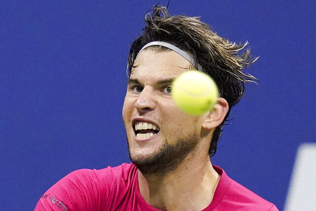 Dominic Thiem, of Austria, returns a shot to Daniil Medvedev, of Russia, during a men's semifinal match of the US Open tennis championships, Friday, Sept. 11, 2020, in New York. (AP Photo/Frank Franklin II)