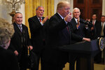 President Donald Trump makes the thumbs up sign as he speaks during a Hanukkah reception, Thursday, Dec. 6, 2018, in the East Room of the White House in Washington. At right is Vice President Mike Pence. (AP Photo/Jacquelyn Martin)
