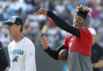 Carolina Panthers quarterback Cam Newton, right, jokes with head trainer Ryan Vermillion, left, during practice at the NFL football team's training camp in Spartanburg, N.C., Thursday, July 25, 2019. (AP Photo/Chuck Burton)