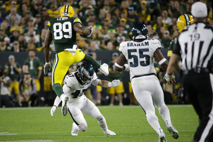 Green Bay Packers tight end Marcedes Lewis hurdles the defense of Philadelphia Eagles linebacker Nate Gerry during the first half of an NFL football game Thursday, Sept. 26, 2019, in Green Bay, Wis. (AP Photo/Mike Roemer)