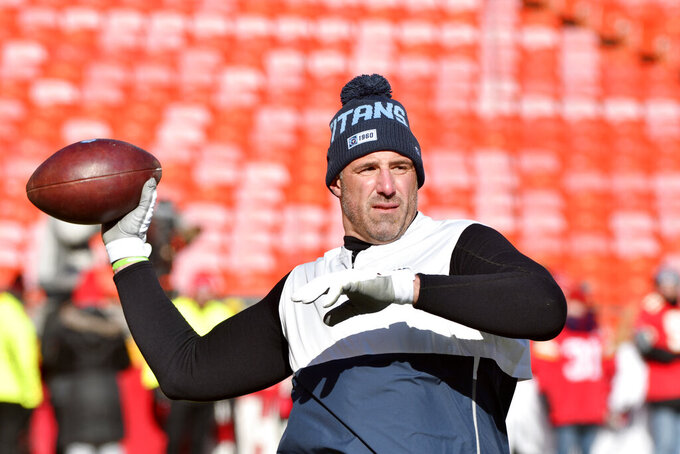 Tennessee Titans head coach Mike Vrabel throws before the NFL AFC Championship football game against the Kansas City Chiefs Sunday, Jan. 19, 2020, in Kansas City, MO. (AP Photo/Ed Zurga)