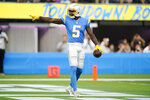 Los Angeles Chargers wide receiver Josh Palmer celebrates after catching a touchdown pass during the first half of a preseason NFL football game against the San Francisco 49ers Sunday, Aug. 22, 2021, in Inglewood, Calif. (AP Photo/Ashley Landis)