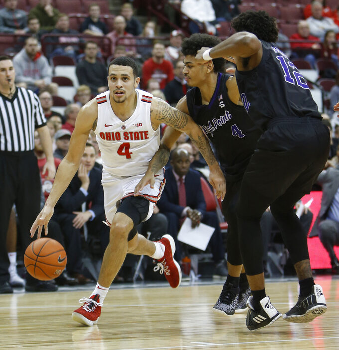 Ohio State's Duane Washington, left, brings the ball up court past High Point's Tim Cameron during the second half of an NCAA college basketball game Saturday, Dec. 29, 2018, in Columbus, Ohio. Ohio State beat High Point 82-64. (AP Photo/Jay LaPrete)