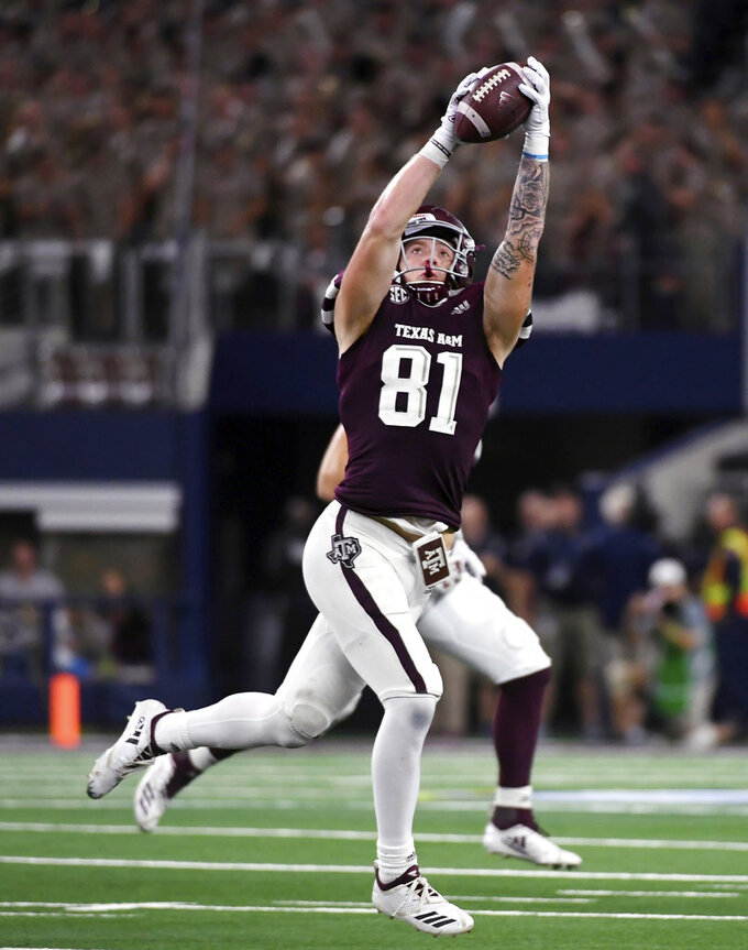 FILE - In this Sept. 29, 2018, file photo, Texas A&M tight end Jace Sternberger (81) hauls in a pass from quarterback Kellen Mond during the second quarter of an NCAA college football game against Arkansas, in Arlington, Texas. Sternberger was named to The Associated Press Midseason All-America team, Tuesday, Oct. 16, 2018.(AP Photo/Jeffrey McWhorter, File)