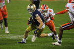 Notre Dame wide receiver Ben Skowronek (11) evades Clemson defensive tackle Tyler Davis (13)*during a carry in the second half of the Atlantic Coast Conference championship NCAA college football game, Saturday, Dec. 19, 2020, in Charlotte, N.C. (AP Photo/Brian Blanco)