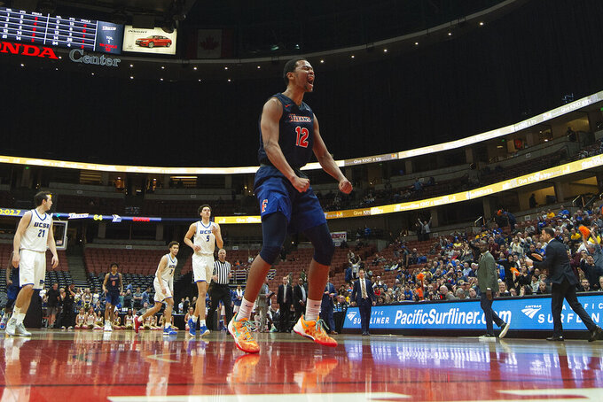 Cal State Fullerton guard Jamal Smith celebrates after defeating UC Santa Barbara in an NCAA college basketball game at the Big West men's tournament in Anaheim, Calif., Friday, March 15, 2019. (AP Photo/Kyusung Gong)