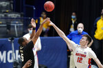 Vanderbilt's D.J. Harvey (5) shoots against Florida's Colin Castleton (12) in the first half of an NCAA college basketball game in the Southeastern Conference Tournament Thursday, March 11, 2021, in Nashville, Tenn. (AP Photo/Mark Humphrey)